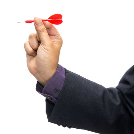 Businessman with red dart in hand