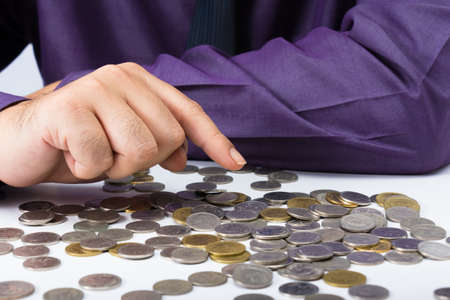 sort out: Closeup businessman counting coins on the table