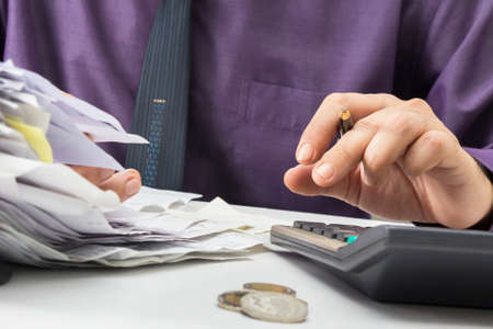 Closeup businessman working with receipts photo