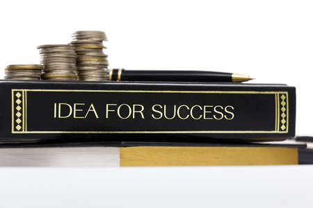 handbook: Success handbook with coins and pen