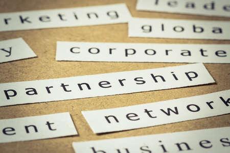Partnership headline, closeup on paper of keyword cloud Stock Photo - 18122063