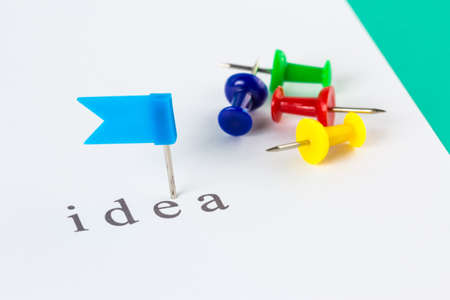 Flag push pin on paper at idea word Stock Photo - 18121899