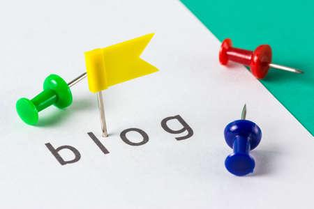 Flag push pin on paper at blog word photo