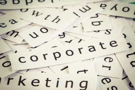 Corporate topic, cut paper on the top of others word Stock Photo - 18319610