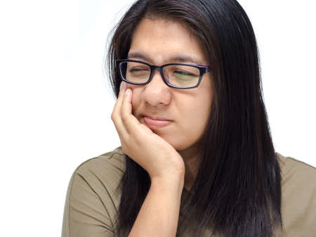 Asian woman suffering from toothache photo