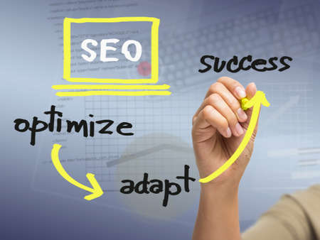 Hand writing SEO strategy concept photo