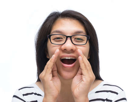 Asian woman cover her mouth and whispering Stock Photo - 18692912