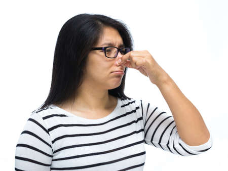 Woman pinching nose caused by bad smell photo