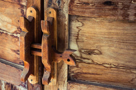 water stained: Obsolete wooden door bolt, Thai tradition Stock Photo