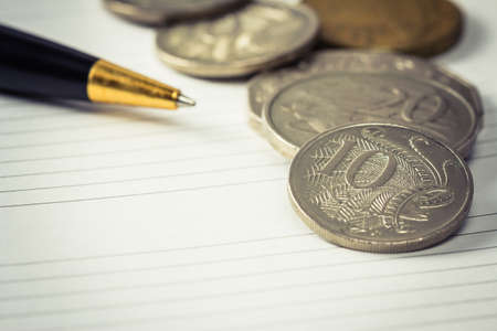 ten empty: Coins on empty page of personal organizer