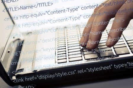 Finger press on laptop keyboard with computer source code Stock Photo - 19072293