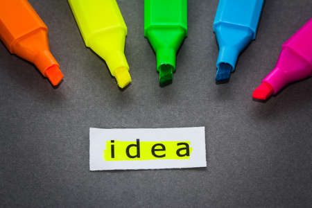Idea word on piece of paper with colorful highlight pens Stock Photo