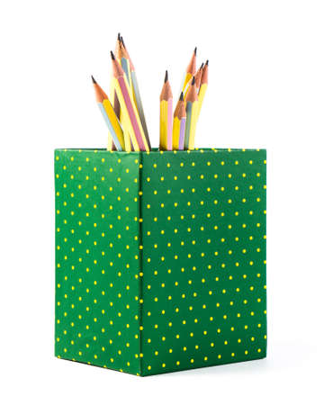 Pencils in polka dots box isolated on white background photo