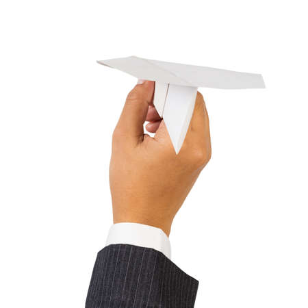 Paper airplane in businessman photo