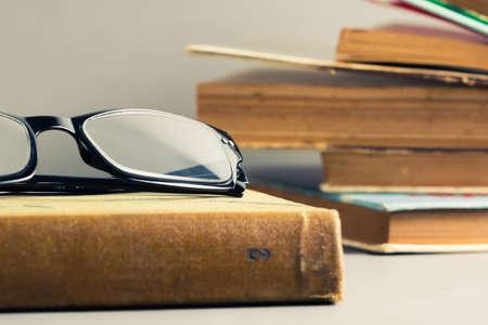 Eyeglasses and old used books photo