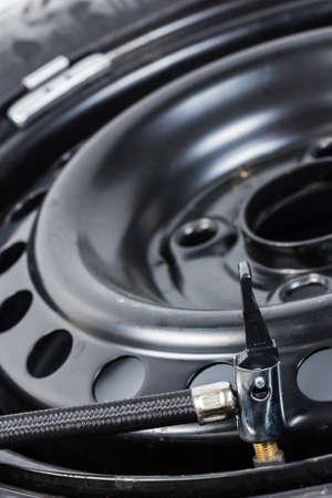 Air compressor tube on spare wheel photo