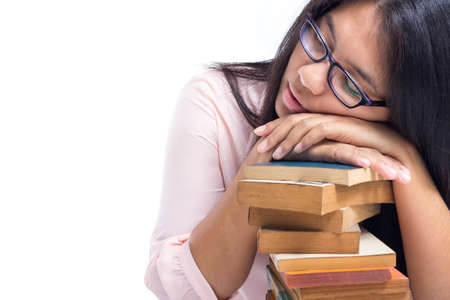Adult student sleep on old books pile with white copy space photo