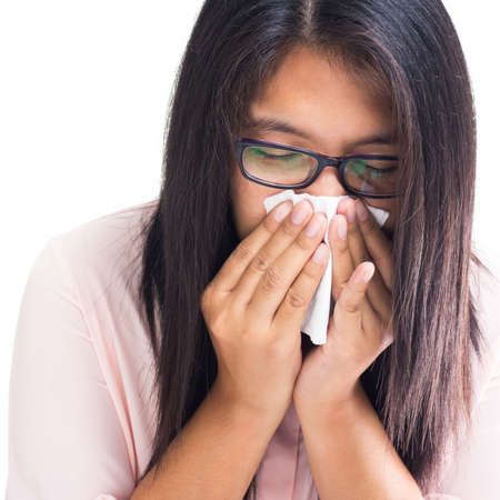 Asain woman got a cold and covering her nose with tissue photo