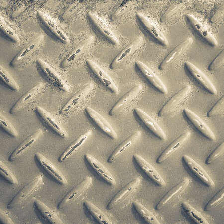 Checker plate metal with rust stain in monotone color Stock Photo - 22298927