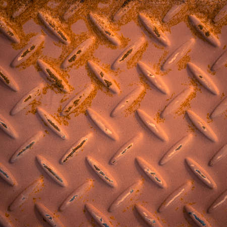 checker plate: Red checker plate metal with rust stain Stock Photo