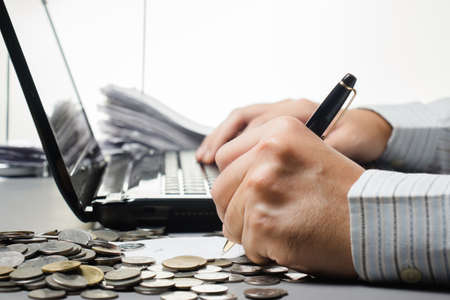 Hand working on finance work Stock Photo - 23134964
