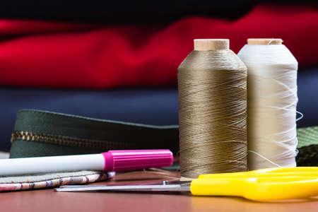 Closeup  thread spools and sewing equipments