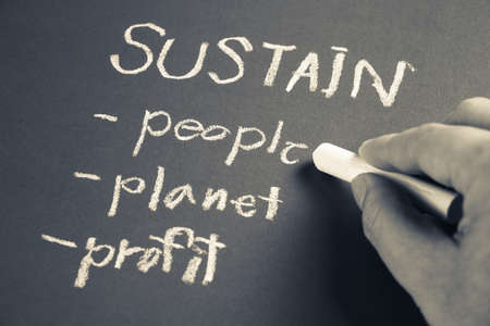 sustain: Hand writing Sustain business concept with chalk