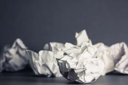 Crumble paper balls on gray ground Stock Photo - 23412866