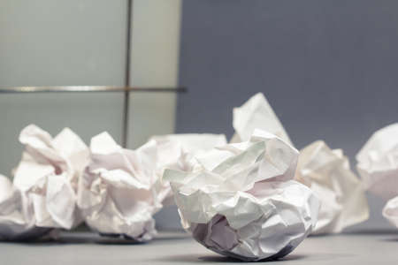 Crumble paper balls on gray ground with part of bin Stock Photo - 23412867