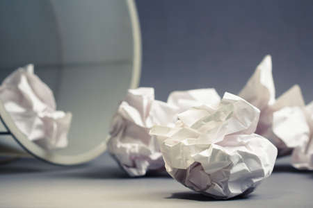 Crumble paper balls spill out of bin Stock Photo - 23412868