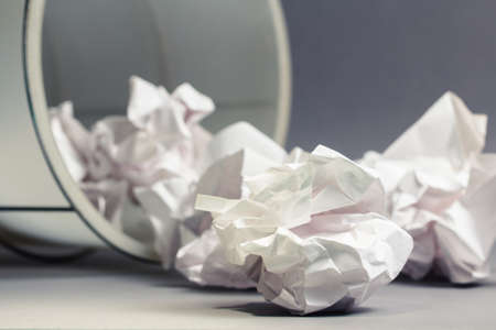 Crumble paper balls spill out of bin Stock Photo - 23412870