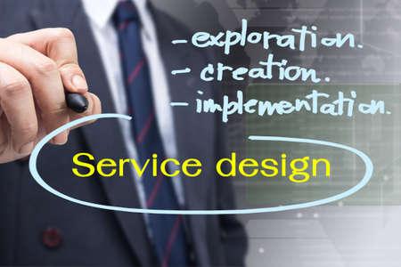 Businessman writing a Service Design concept, development of customer relationship management photo