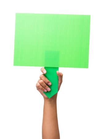 green sign: Mano che mostrano un segno verde vuoto isolato su sfondo bianco
