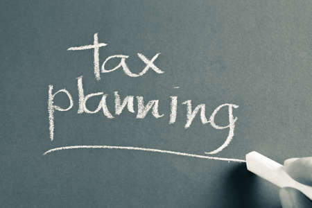 Hand writing Tax Planning word with chalk 写真素材