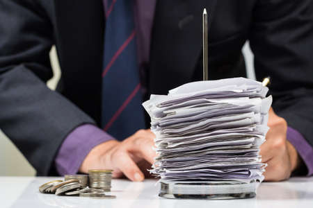Businessman working with bills in paper nail Stock Photo - 24933995