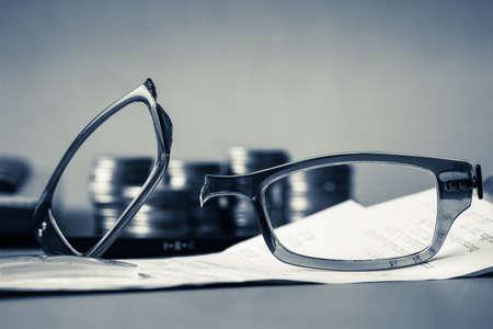 failed plan: Broken eyeglasses on business desk