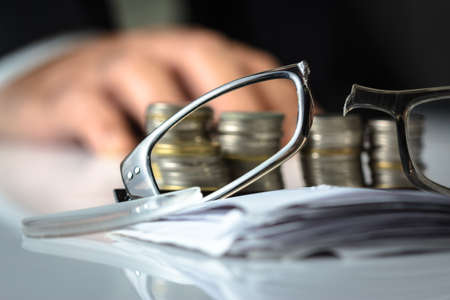 financial obstacle: Broken eyeglasses on financial desk, losing money or business ruined concept