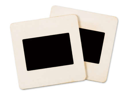 Old slide film mounts made of paper isolated on white background