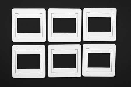 reversal: Old slide film mounts on black paper background Stock Photo