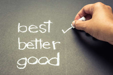 Hand writing correct mark with chalk on the best choice Stock Photo