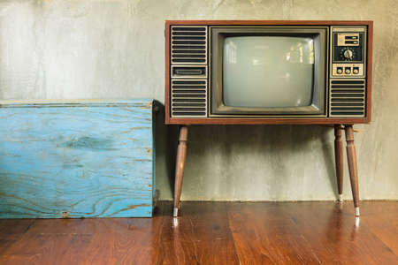 old television: Retro television with blue wood container in the old room Stock Photo