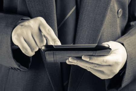 Closeup businessman using digital tablet photo