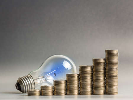 Heap of coins stairs with light bulb for financial plan or business idea concept photo