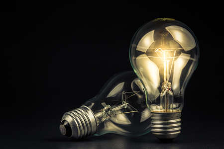 Light bulb shining in the darkness Stock Photo - 27996088