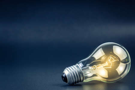 Light bulb shining with copy space Stock Photo