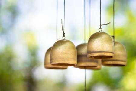 Closeup brass wind chimes in the garden 写真素材