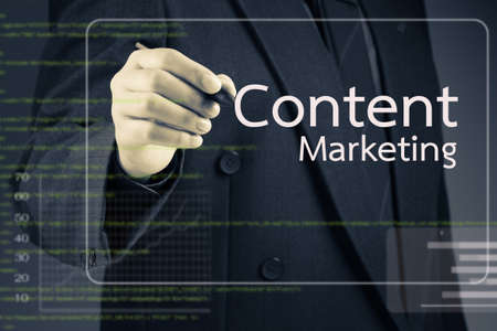 Businessman pointing at Content Marketing article on screen photo