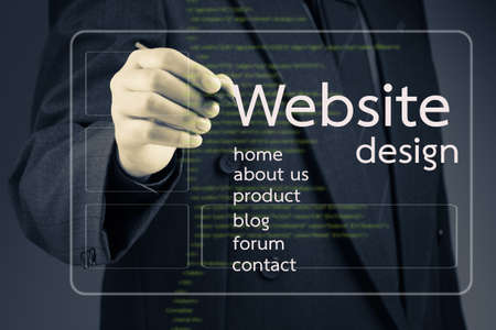 Businessman pointing at Website design article on screen photo