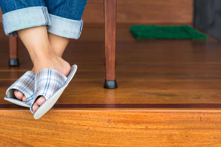 floor cloth: Closeup woman feet in cloth slippers on clean wood floor