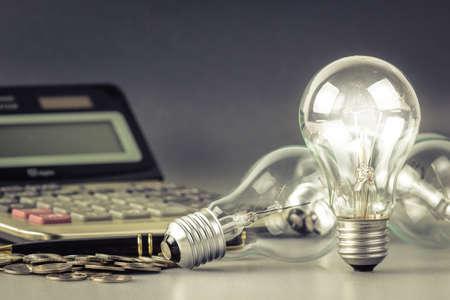 Light bulb on financial desk
